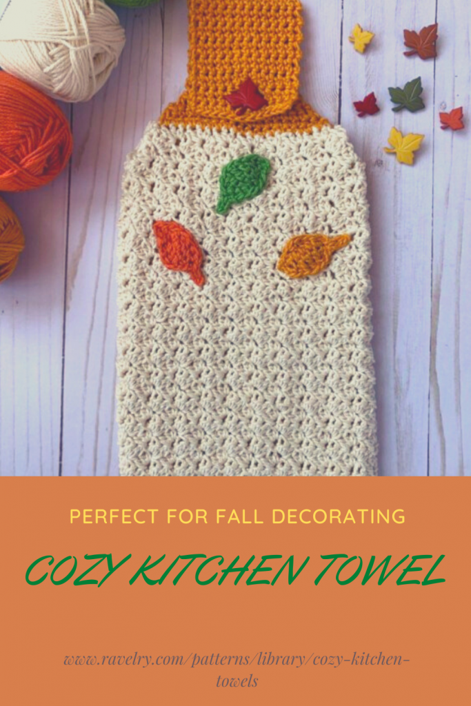 Pinterest Pin with a cozy kitchen towel in autumn colors with leaf decorations. Leaf buttons and yarn in the background.