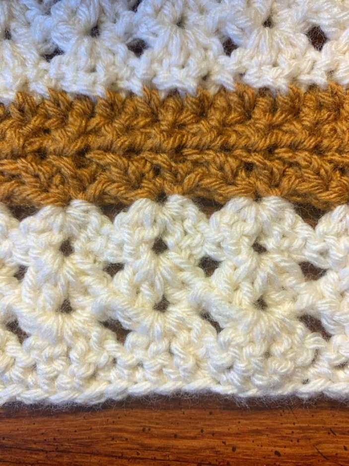 Close up of first 8 rows of crochet cuffed scarf.