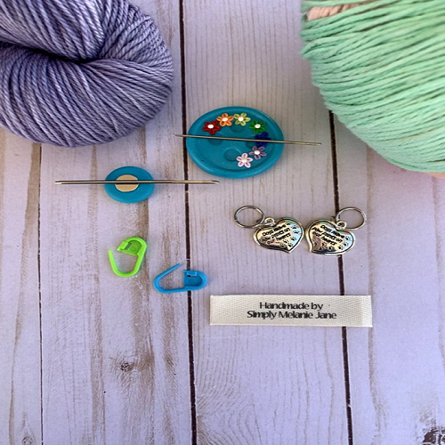 Crochet tools including needles, needle minders, and stitch markers.