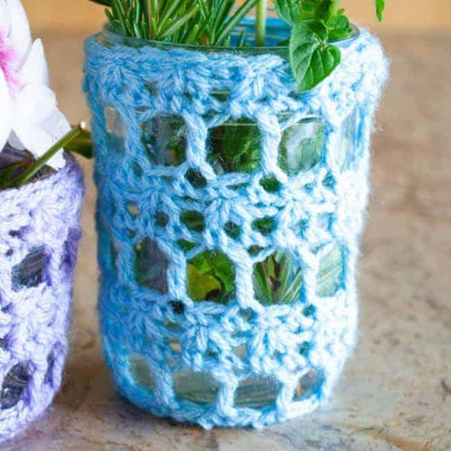 A blue crochet cozy for a mason jar for spring home décor.