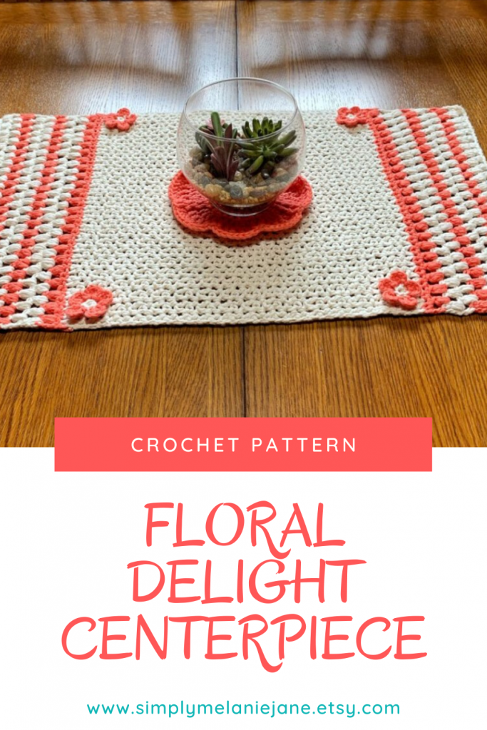 Pinterest pin showing a crochet table runner in cream and coral colors. A globe of succulents sits in the middle of it.
